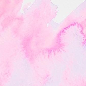 Coup de pinceau aquarelle rose sur fond de papier