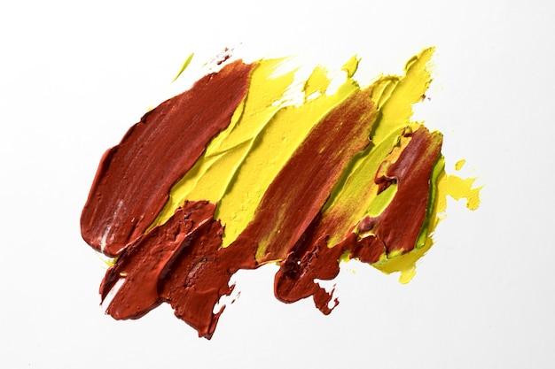 Coup de pinceau marron et jaune vue de dessus