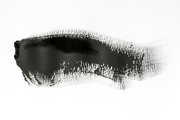 Coup de pinceau noir sur fond blanc