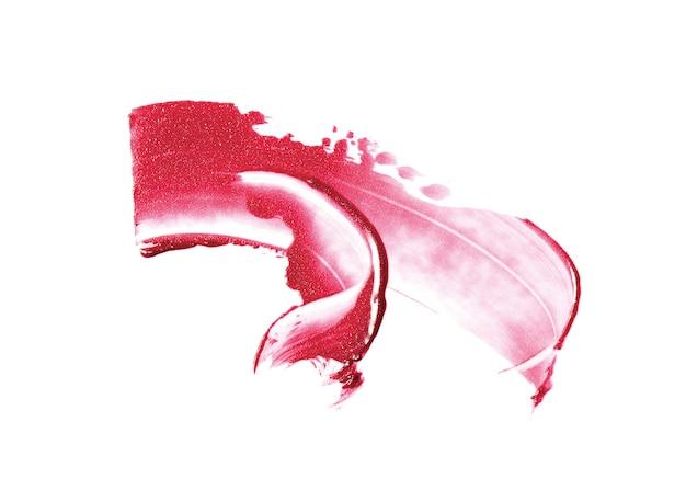 Coup de pinceau rouge à lèvres isolé sur blanc