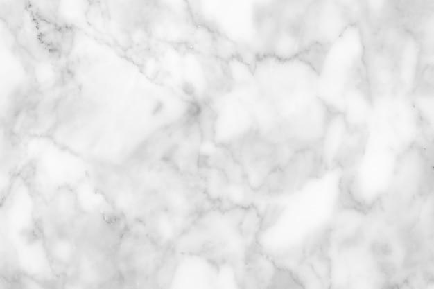 Coup plein cadre de fond de texture de marbre blanc.