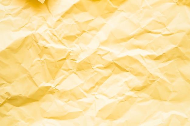 Coup plein cadre de fond texturé en papier jaune