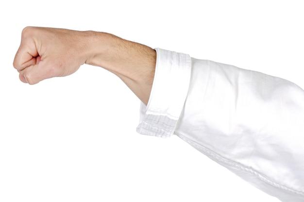 Un coup de poing de karaté sur fond blanc