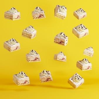 Coupe des gâteaux flottant sur fond jaune. concept de nourriture idée minimale.