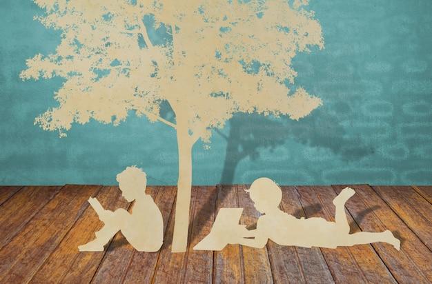 Coupe de papier d'enfants lire un livre sous l'arbre