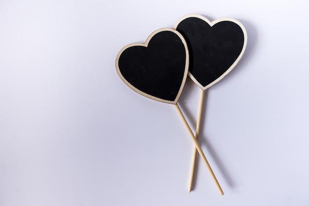Couple de coeurs noirs. concept de la saint-valentin