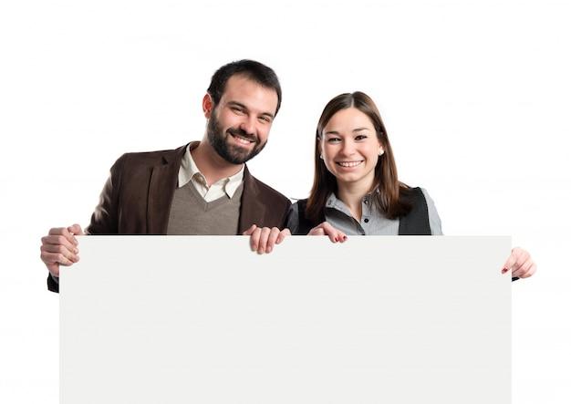 Couple, tenue, plaque, sur, arrière-plan blanc