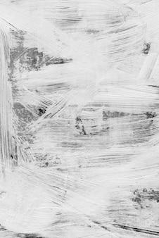 Coups de pinceau blanc abstrait texture texture blanc peinture motif sur mur foncé.