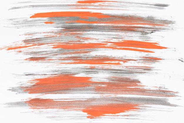 Coups de pinceau gris et orange