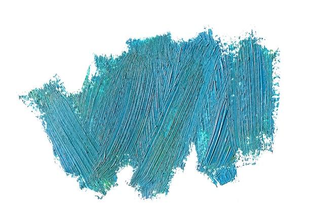 Coups de pinceau de peinture grasse bleue, isolés sur blanc