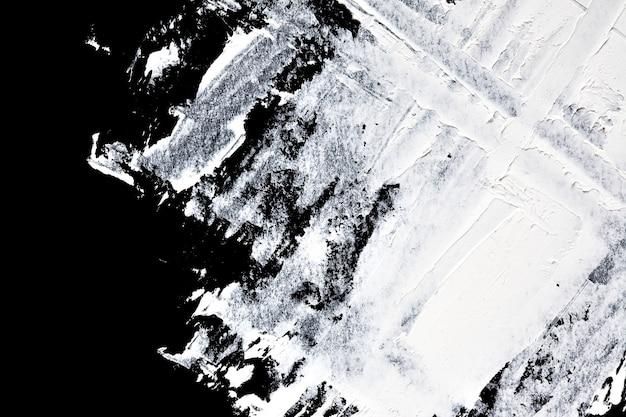 Coups de pinceau de peinture à l'huile blanche sur fond noir - composition abstraite et espace pour le texte