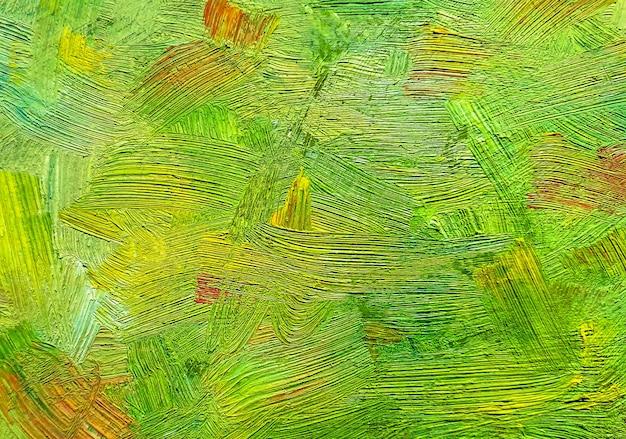 Coups de pinceau de peinture verte sur toile.