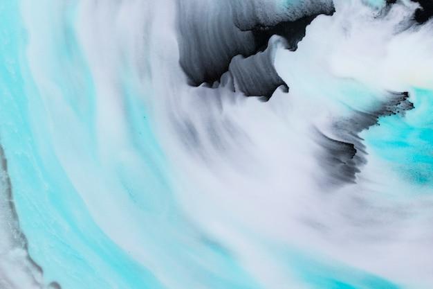 Coups de pinceau texturés en couleur noir et turquoise sur fond