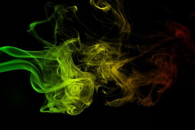 Courbes de fumée de fond abstrait et couleurs de reggae d'onde
