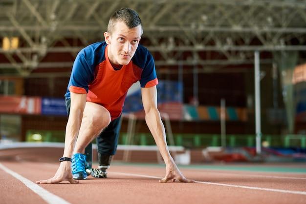 Coureur handicapé au démarrage