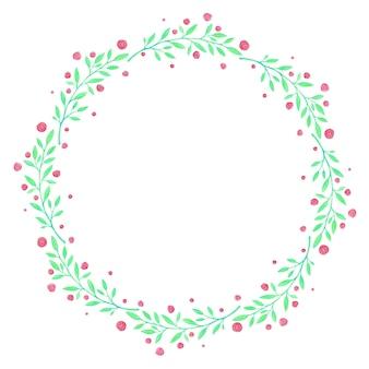 La couronne de feuilles vertes et de petites fleurs rouges