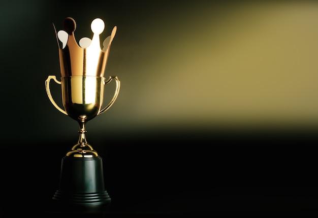 Couronne d'or en carton sur le dessus du champion trophée d'or.