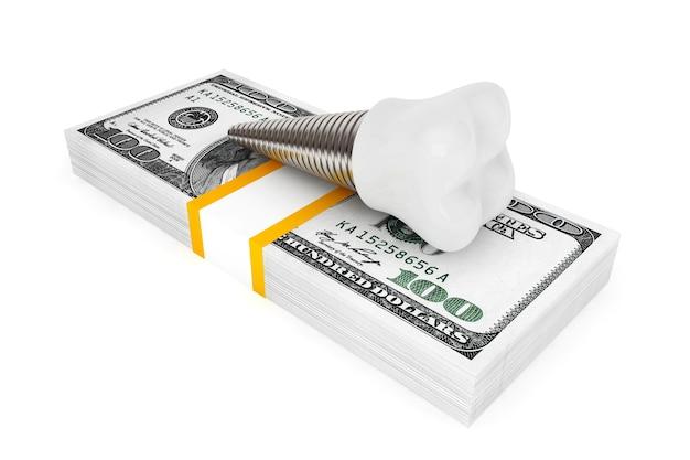 Coût du concept dentaire. implant dentaire avec de l'argent sur fond blanc