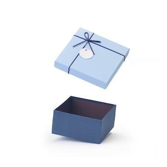 Couvercles de boîte-cadeau de papier vide ouvert bleu flottant isolé sur blanc