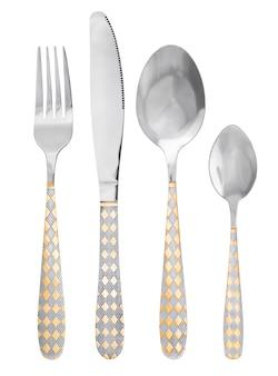 Couverts sur fond blanc. couverts en métal avec motif or