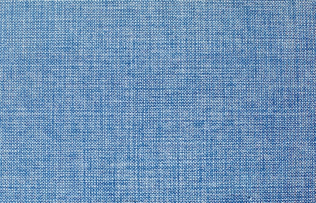 Une couverture de livre en tissu vintage avec un fond bleu