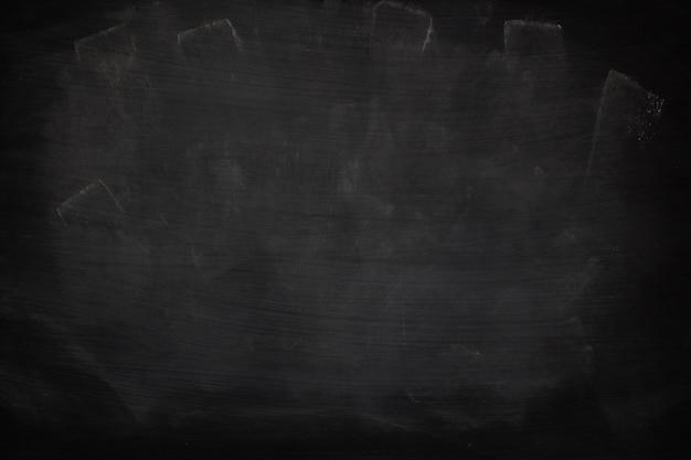 Craie abstraite de texture sale grunge noir frotté sur fond de tableau noir ou de tableau.