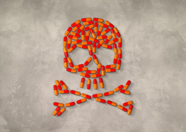Crâne fait de pilules capsule orange isolé sur fond de béton. illustration 3d