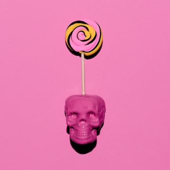 Crâne et sucette. mode d'humeur rose bonbon