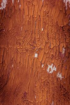 Craquage de vieille peinture orange sur le mur de texture