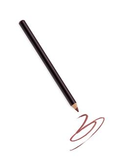 Crayon eye-liner brun et trait isolé sur blanc