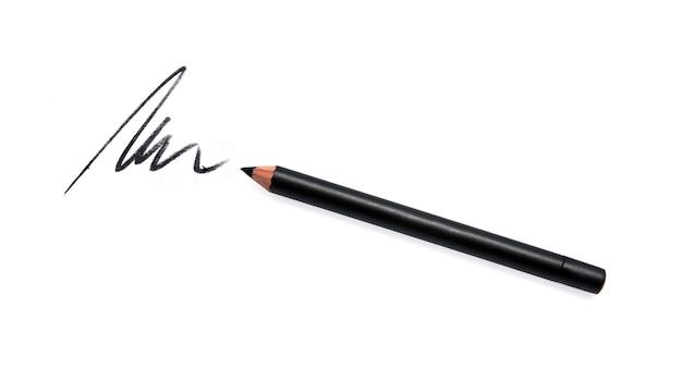 Crayon eye-liner noir et trait isolé sur blanc