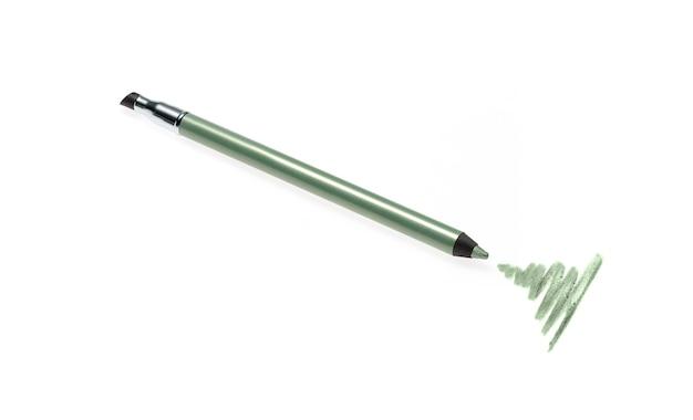 Crayon eye-liner vert et trait isolé sur blanc