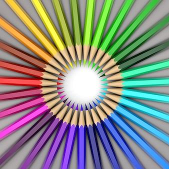 Crayons de couleur répartis en cercle. toutes les couleurs de l'arc-en-ciel.