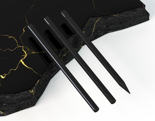 Crayons noirs sur marbre élégant