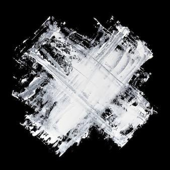 Croix - coups de pinceau expressifs de peinture blanche sur fond noir