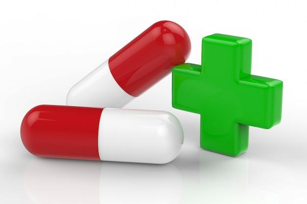 Croix verte et pilule capsule sur fond blanc