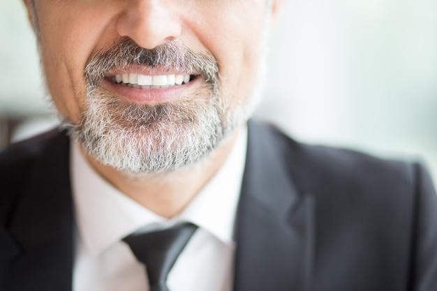 Cropped view of smiling business leader