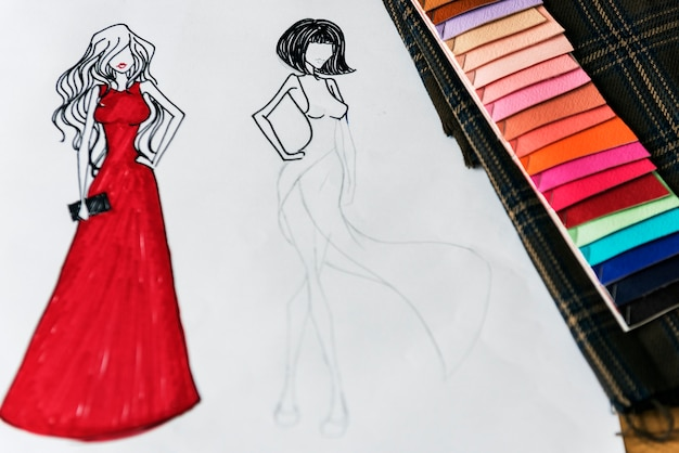 Un croquis de deux femmes portant une robe