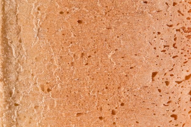 Croûte de gros plan abstrait de texture de fond de pain blanc