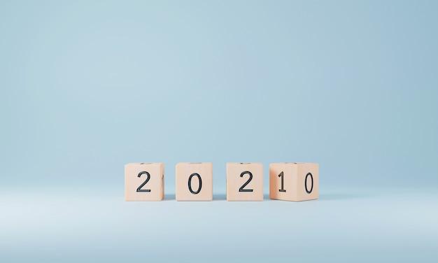 Cubes en bois retournant le changement nouvel an