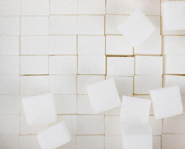 Cubes de sucre blanc vue de dessus de fond texturé. morceau de sucre blanc raffiné