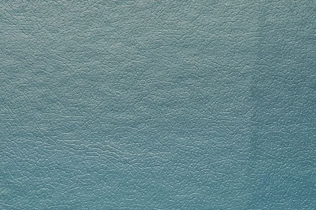 Cuir synthétique bleu pour le fond. gros plan sur la macrophotographie détaillée du matériau de décoration de texture, la conception de fond pour l'affiche, la brochure, le livre de couverture et le catalogue.