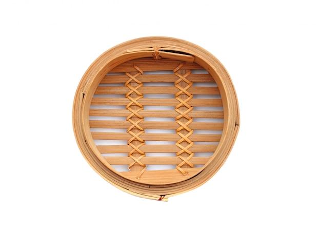 Cuiseur vapeur dim sum en bambou sur blanc