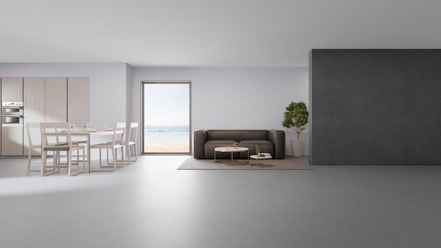 Cuisine, salle à manger et salon avec vue sur la mer d'une maison de plage de luxe au design moderne.