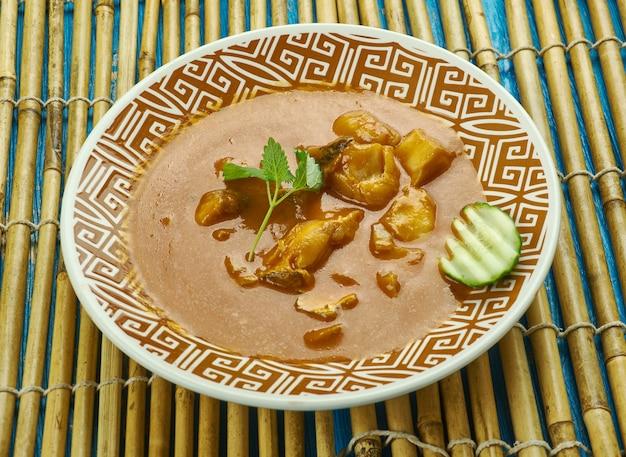 Curry de poisson alleppey - curry de poisson épicé de style kerala qui est légèrement piquant en raison de l'utilisation de mangues crues ou de tamarin.