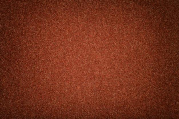 Daim mat orange foncé texture velours en feutre,
