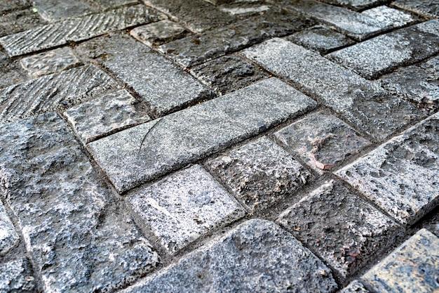 Dalles de pavage de rue formées dans un ornement en mosaïque