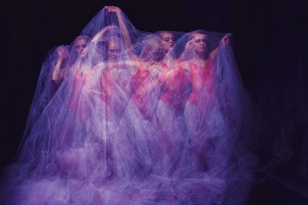 Danse sensuelle et émotionnelle de la belle ballerine à travers le voile