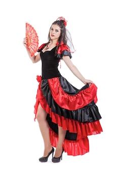 Danseuse espagnole traditionnelle de flamenco dans une robe rouge avec ventilateur