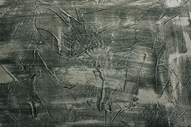 Décor de fond de plâtre vénitien de texture de pierre sans couture grunge gris dramatique. décoration de ciment en béton grungy fissuré.